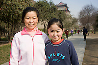 Mother and child in park by City Wall, Xian. China has a one child family planning policy to reduce population.