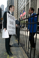 29 August 2005 - New York City, NY - Recent MBA graduate Christopher Barth walks around the Wall Street area of downtown Manhattan in New York City, USA, handing out his resume, 29 August 2005. Barth says he found traditional methods of job hunting unsatisfactory and wanted to try something different. Photo Credit: David Brabyn.