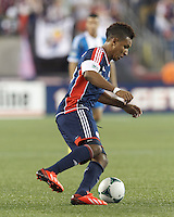 New England Revolution forward Juan Agudelo (10) collects a pass.  In a Major League Soccer (MLS) match, the New England Revolution (dark blue) defeated Philadelphia Union (light blue), 5-1, at Gillette Stadium on August 25, 2013.
