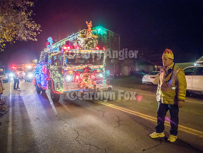 Ione Fire Department's Christmas cruise through downtown Ione, California.<br /> <br /> Lighted fire truck with Santa Claus drives through the city each December to create good will,  fire-prevention awareness and community good will.