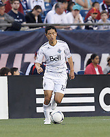Vancouver Whitecaps FC defender Young-Pyo Lee (12) brings the ball forward. In a Major League Soccer (MLS) match, the New England Revolution defeated Vancouver Whitecaps FC, 4-1, at Gillette Stadium on May 12, 2012.