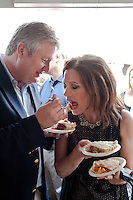 Marcus Bachmann feeds a bite of pie to his wife, Republican presidential hopeful Michele Bachmann, at a campaign stop at the Story County Fair on Saturday, July 23, 2011 in Nevada, IA.