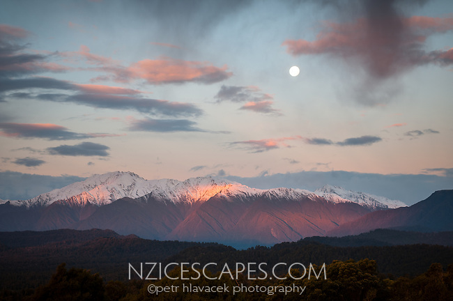 Full moonrise over Mt. Adams at sunset, Westland National Park, West Coast, UNESCO World Heritage Area, New Zealand, NZ