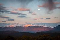 Full moonrise over Mt. Adams at sunset, Westland National Park, West Coast, UNESCO World Heritage Area, New Zealand, NZ