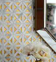 Joie, a stone water jet cut mosaic, shown in Gold Glass and polished Calacatta Gold.