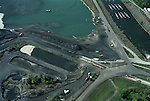 Aerial View: Coal waste (fly ash) and holding ponds from coal burning power plant a pollution control facility is at right Hopewell Virginia
