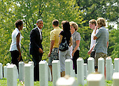 (ISP POOL PHOTO) President Barack Obama and First Lady Michelle Obama visit Section 60 at Arlington National Cemetery, on Saturday, September 10, 2011, in Washington, DC.  This section contains military personnel who were killed in the Iraq and Afghanistan wars since 9/11.  (Photo by Leslie E. Kossoff/Polaris Images).Credit: Leslie E. Kossoff / Pool via CNP