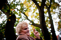 A woman has a cigarette outside a cafe in Tallinn, Estonia on Sept. 25, 2009. The young democracy joined the European Union in 2004 and since has been working on getting the euro as its national currency. Estonia has one of the highest per capita incomes in central europe.