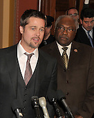 Washington, DC - March 5, 2009 -- Brad Pitt speaks to press after meeting with Democratic leadership in the U.S. Capitol in Washington, D.C. on Thursday, March 5, 2009.  House Democratic Whip James E. Clyburn (Democrat of South Carolina) looks on from right..Credit: Ron Sachs / CNP
