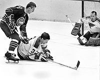Seals vs Blues 1968-69: Seals Billy Harris defended by Flyer Al Arbourand goalie Glenn Hall..(photo/Ron Riesterer)