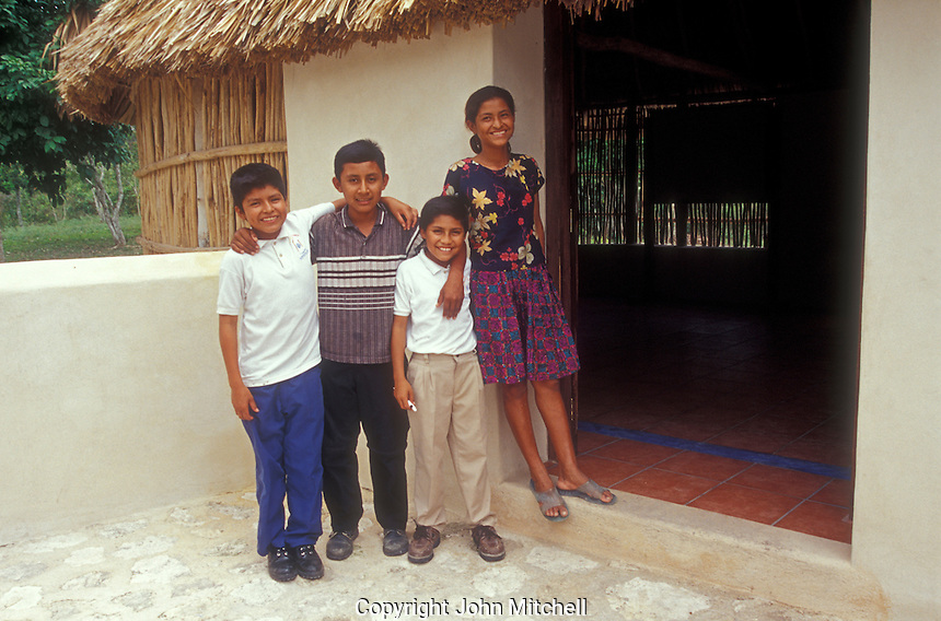 Well-dressed and smiling Mayan children at the Becan archaeological site, Campeche state, Mexico