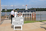 job #40242. 5/11/11  -- Vicksburg, MS, U.S.A. --Toursits and resiodent watch the waters rise into the historic Vicksburg Mississippi RailRoad Station as fire and rescue crews sand bags around to help protect it. Vicksburg folks work around the clock fill  sand bags try to sand bag their property from the over flow of the MS River. Vicksburg, a riverfront town steeped in war and sacrifice, gets set to battle an age-old companion: the Mississippi River. The city that fell to Ulysses S. Grant and the Union Army after a painful siege in 1863 is marshaling a modern flood-control arsenal to keep the swollen Mississippi from overwhelming its defenses. --Photo©SuziAltman.com...Photo by Suzi Altman, Freelance.