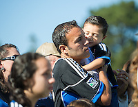 SANTA CLARA, CA - October 26, 2013: San Jose Earthquake midfielder Ramiro Corrales and one of his sons during the pre game ceremonies before the San Jose Earthquakes vs FC Dallas match in Buck Shaw Stadium in Santa Clara, CA. Final score SJ Earthquakes 2, FC Dallas 1.
