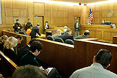 Manassas, VA - November 13, 2002 -- John Allen Muhammad and his court appointed attorney Peter Greenspun, left standing at table, appear before Judge Leroy F. Millette  at the Prince William County courthouse  in Manassas, Virginia, Wednesday November 13, 2002.   The court appearance was to appoint defense counsel..Credit: Jahi Chikwendiu - Pool via CNP
