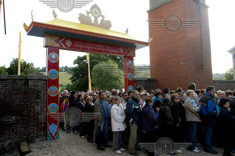 The public line-up before the arrival of His Holiness the Dalai Lama to the Vajradhara Ling Buddhist Temple during the visit of His Holiness to France. The Dalai Lama blessed a project to build a Temple for Peace at the centre and gave a speech to hundreds of guests.