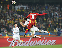 Ghana's Jonathan Mensah escapes a red card on this vicious foul on U.S. forward Clint Dempsey. Ghana defeated the U.S., 2-1, in extra time to advance to the quarterfinals, Saturday, June 26th, at the 2010 FIFA World Cup in South Africa..