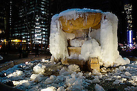 A frozen fountain is seen as the temperatures are set a record low in New York. 15.02.2015. Eduardo Munoz/VIEWpress.