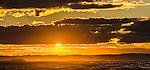 The setting sun over Stockton Beach  in Port Stephens, NSW Australia