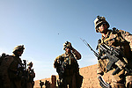 U.S. Marines from Company L, 3rd Battalion, 6th Marine Regiment arrive at an abandoned school that Taliban fighters are believed to be using as a base near Marjah, Afghanistan. March 10, 2010. DREW BROWN/STARS AND STRIPES
