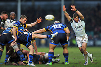 Charlie Mulchrone of Worcester Warriors box-kicks the ball as Jonathan Evans of Bath Rugby looks to charge him down. Aviva Premiership match, between Worcester Warriors and Bath Rugby on February 13, 2016 at Sixways Stadium in Worcester, England. Photo by: Patrick Khachfe / Onside Images