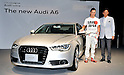 Audi Japan President, Hiroshi Okita and German auto racing driver, Andre Lotterer (R) pose for camera during a press conference in Tokyo, Japan, on August 23, 2011. (Photo by AFLO)