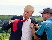 Donald Trump, a candidate for the 2016 Republican nomination for President of the United States, adjusts his tie as he prepares for an interview after appearing at the ribbon cutting for the Albemarle Estate at the Trump Winery in Charlottesville, Virginia on Tuesday, July 14, 2015. <br /> Credit: Ron Sachs / CNP<br /> <br /> (RESTRICTION: NO New York or New Jersey Newspapers or newspapers within a 75 mile radius of New York City)