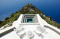 Swiss-Greek interior designer Marina Anouilh and husband Nicholas Anouilh  (son of  eminent French writer Jean Anouilh) delight in spending time at their island home in Kefalonia, Greece.  The house is built  at the top of a gorge, overlooking two of the most beautiful beaches in the Mediterranean.