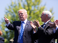 United States President Donald J. Trump makes remarks as Vice President Mike Pence applauds at the 36th Annual National Peace Officers Memorial Service at the US Capitol in Washington, DC, May 15, 2017.<br /> Credit: Chris Kleponis / Pool via CNP /MediaPunch
