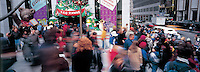 """Out takes from """"The Harvard Design School Guide to Shopping"""" published by Tashen. christmas shoppers on 5th ave. outside of FAO Schwartz in line waiting to enter the store. NYC 2000"""