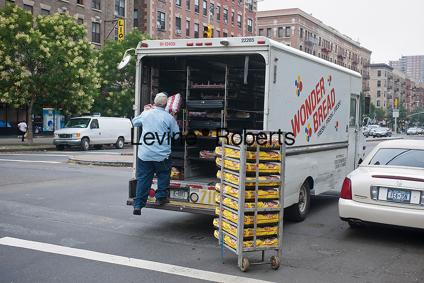 A delivery of Wonder Bread and other Hostess brands to a supermarket in the Harlem neighborhood of New York on Saturday, July 28, 2012. The iconic maker of Twinkies, as well as Wonder Bread and other favorites foods has entered Chapter 11 for the second time in ten years having been saddled with almost $1 billion in debt. (© Richard B. Levine)