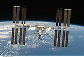 In Earth Orbit - March 25, 2009 -- Backdropped by the blackness of space and the Earth's horizon, the International Space Station is seen from Space Shuttle Discovery as the two spacecraft begin their relative separation. Earlier the STS-119 and Expedition 18 crews concluded 9 days, 20 hours and 10 minutes of cooperative work onboard the shuttle and station. Undocking of the two spacecraft occurred at 2:53 p.m. (CDT) on March 25, 2009..Credit: NASA via CNP