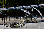 The crushed wreckage of a ladies bike lies on the surface of the A3 Kennington Park Road at the junction with A23 Kennington Road, south London. A woman in her twenties was taken to King's College Hospital with a leg injury after a crash between a bus and a cyclist this morning. Emergency services were called to Kennington Park Road at 9.30am. A London Buses statement reads: ?At around 09:30 this morning a route 333 bus, operated by London General, was involved in a collision with a cyclist ..&quot;