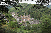 View of the medieval town of Conques, Aveyron, Midi-Pyrenees, France, and the Abbatiale Sainte-Foy de Conques or Abbey-church of Saint-Foy, a Romanesque abbey church begun 1050 under abbot Odolric to house the remains of St Foy, a 4th century female martyr. The church is on the pilgrimage route to Santiago da Compostela, and is listed as a historic monument and a UNESCO World Heritage Site. Picture by Manuel Cohen