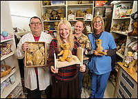 BNPS.co.uk (01202 558833)<br /> Pic: PhilYeomans/BNPS<br /> <br /> Rikey with her bear hospital team and some very poorly patients.<br /> <br /> Broken bears and deteriorating dolls from all over the world are being brought back to life by a UK team of dedicated doctors and nurses at one of the last remaining toy hospitals.<br /> <br /> The team at Alice's Bear Shop, a teddy bear and doll hospital in Lyme Regis, Dorset, perform all kinds of 'surgery' from simple restringing and re-stuffing to head re-attachments and complete skin grafts.<br /> <br /> Rikey Austin, 49, opened the hospital in January 2000 but also ran a shop and only repaired one or two toys a month.<br /> <br /> Now she has a four-month waiting list for patients and has had to close the shop to focus on the hospital side of the business.
