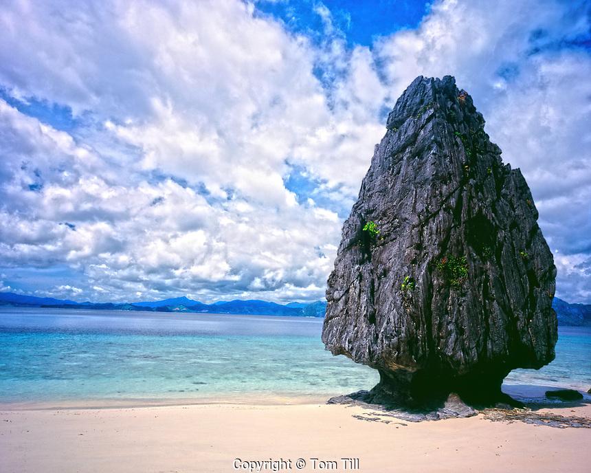Limestone pinnacle on Thing Beach, Bacuit Bay, Philippines, El Nido, protected Area. limestone pinnacles in South China Sea