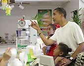Honolulu, HI - December 26, 2008 -- United States President-elect Barack Obama points out different flavors of shave ice to youngest daughter Sasha at Kokonuts Shave Ice and Snacks at Koko Head Marina shopping mall Friday, December 26, 2008 in Honolulu, Hawaii. .Credit: Kent Nishimura - Pool via CNP