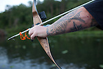 Detail of the tattooed arm of Mike Brookover while he bow fishes on Aquia Creek, Virginia on June 20, 2013. CREDIT: Lance Rosenfield