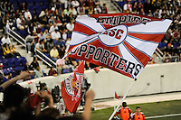 Members of the Empire Supporters Club wave a flag during the second half of a friendly between Sanots FC and the New York Red Bulls at Red Bull Arena in Harrison, NJ, on March 20, 2010. The Red Bulls defeated Santos FC 3-1.