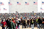 Crowd with flagpoles amid them in January 2009 at the base of the Washington Monument in Washington, DC during the inauguration of President Barack Obama.
