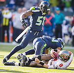 Seattle Seahawks linebacker Bruce Irvin (51)) and strong safety Kam Chancellor  sacks Tampa Bay Buccaneers quarterback Mike Glennon (8) in the second quarter at CenturyLink Field in Seattle, Washington on November 3, 2013.  Glennon completed 17 of 23 passes for 168 yards for two touchdowns in the Seahawks come from behind win over  the Buccaneers 27-24 in overtime. ©2013. Jim Bryant. All Rights Reserved.