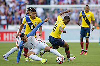 Seattle, WA - Thursday, June 16, 2016: United States forward Bobby Wood (7) and Ecuador midfielder Carlos Gruezo (18) collide during the Quarterfinal of the 2016 Copa America Centenrio at CenturyLink Field.