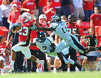 Da'Rel Scott of the Terrapins runs by the FIU defenders for a touchdown. Maryland defeated FIU 42-28 during a game at Capital One Field at Byrd Stadium in College Park, MD on Saturday, September 25, 2010. Alan P. Santos/DC Sports Box