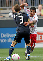 CHESTER, PA - OCTOBER 27, 2012:  Chris Albright (3) of the Philadelphia Union holds up  Tim Cahill (17) of the New York Red Bulls during an MLS match at PPL Park in Chester, PA. on October 27. Red Bulls won 3-0.