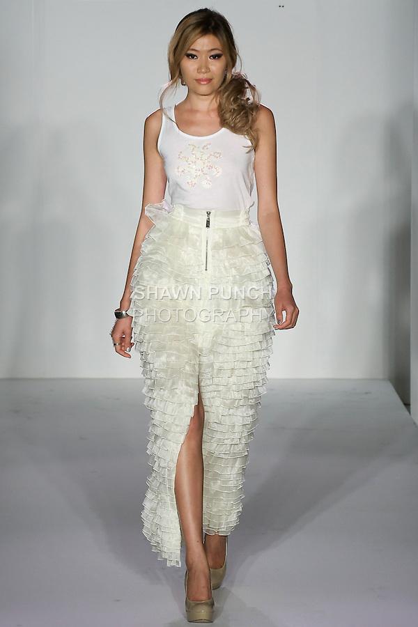 Model walks runway in an outfit Gulzhan Rysbekova, for her Guljan YRYS fashion show, during Couture Fashion Week Spring 2012.