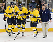 Kyle Bigos (Merrimack - 3), Bobby Kramer (Merrimack - 10), Fraser Allen (Merrimack - 2), Mike Hurley (Merrimack - Trainer) - The University of Notre Dame Fighting Irish defeated the Merrimack College Warriors 4-3 in overtime in their NCAA Northeast Regional Semi-Final on Saturday, March 26, 2011, at Verizon Wireless Arena in Manchester, New Hampshire.