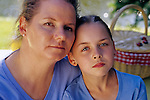 Mother and daughter portrait at picnic along lake