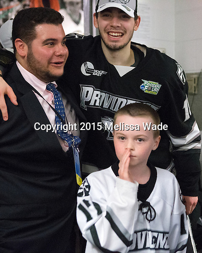 ?, Jake Walman (PC - 19), Kevin Rich (PC - 17) - The Providence College Friars celebrated their national championship win after the Frozen Four final at TD Garden on Saturday, April 11, 2015, in Boston, Massachusetts.
