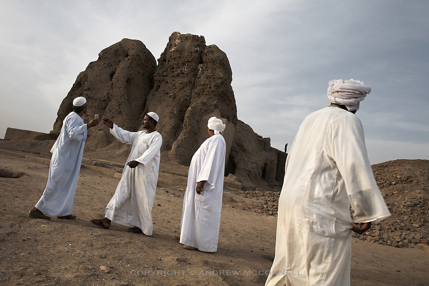 Sudanese tourists in front of the Western Deffufa, once the centre of the city of Kerma, pictured on Friday, March 23, 2007. Kerma was the seat of the first independent kingdom of Kush and the Western Deffufa dates from the earliest Kushite period putting it at over 3,500 years old. Deffufa is a Nubian term meaning mud-brick building and the Western Deffufa is the largest and possibly oldest structure in sub-Saharan Africa...The ancient kingdom of Kush emerged around 2000 BC in the land of Nubia, what is today northern Sudan. At their height the Nubians ruled over ancient Egypt as the 25th Dynasty between 720 BC and 664 BC (known as the Black Pharaohs) and saw their borders reach to edges of Libya and Palestine. The Kushite kings saw themselves as guardians of Egyptian religion and tradition. They centered there kindgom on the Temple of Amun at Napata (modern day Jebel Barkal) and brought back the building of Pyramids in which to inter their kings - there are around 220 pyramids in Sudan, twice the number in Egypt. After Napata was sacked, by a resurgent Egypt, the capital was moved to Meroe where a more indigenous culture developed, Egyptian hieroglyphics made way for a cursive Meroitic script, yet to be deciphered. The Meroitic kingdom eventually fell into decline in the 3rd century AD with the arrival of Christianity.