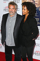 HOLLYWOOD, LOS ANGELES, CA, USA - NOVEMBER 11: Luc Besson, Virginie Silla arrive at the AFI FEST 2014 - 'The Homesman' Gala Screening held at the Dolby Theatre on November 11, 2014 in Hollywood, Los Angeles, California, United States. (Photo by Xavier Collin/Celebrity Monitor)