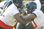 Mississippi's Carlton Martin (92) and Kentrell Lockett (40) go through a drill at  football practice in Oxford, Miss. on Sunday, August 7, 2011. (AP Photo/Oxford Eagle, Bruce Newman)
